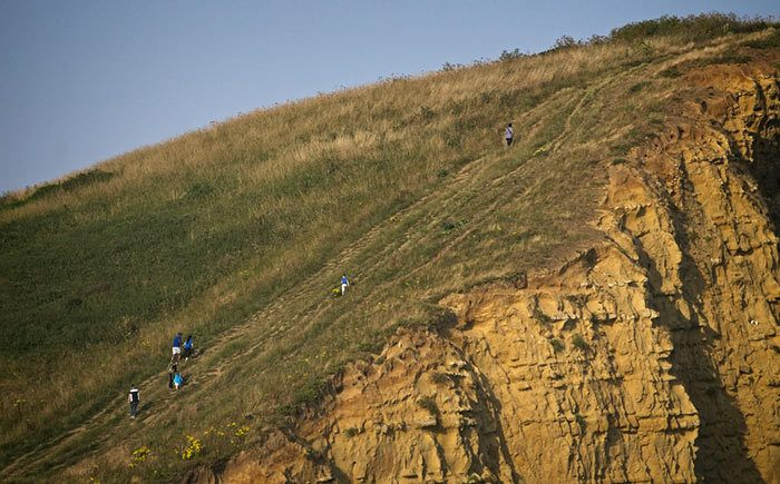 People Climbing West Bay Cliffs in Dorset